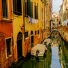 Residential Canal with moored boats in Venice