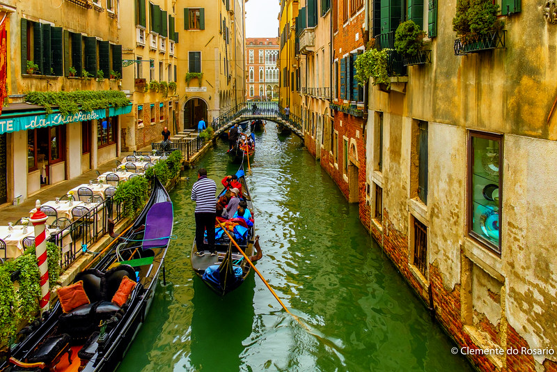 Gondolas Rider and Seranade for tourists in Venice Itlaly