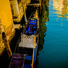 Venetian Canal Reflections with a Gondola