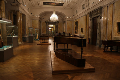 "Inside the Neue Burg - Touring the ""Collection of Ancient Musical Instruments"" museum within the complex."