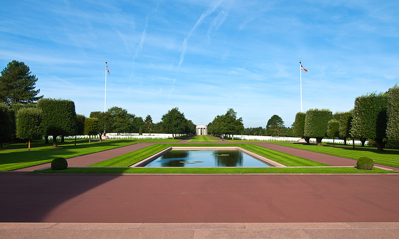 The cemetery contains the remains of nearly ten thousand, most of whom died at Normandy.; it also contains the names of another 1500+ whose bodies were never found there.