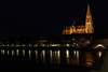 A night shot of the Cathedral in Regensburg, Germany taken from the old bridge.