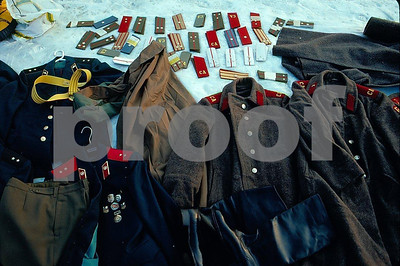 Soviet Union and East German military hats for sale spread on a blanket in the snow by the Brandenburg Gate in West Berlin after the wall came down.