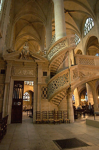 An elaborate staircase inside Saint-Etienne-du-Mont.