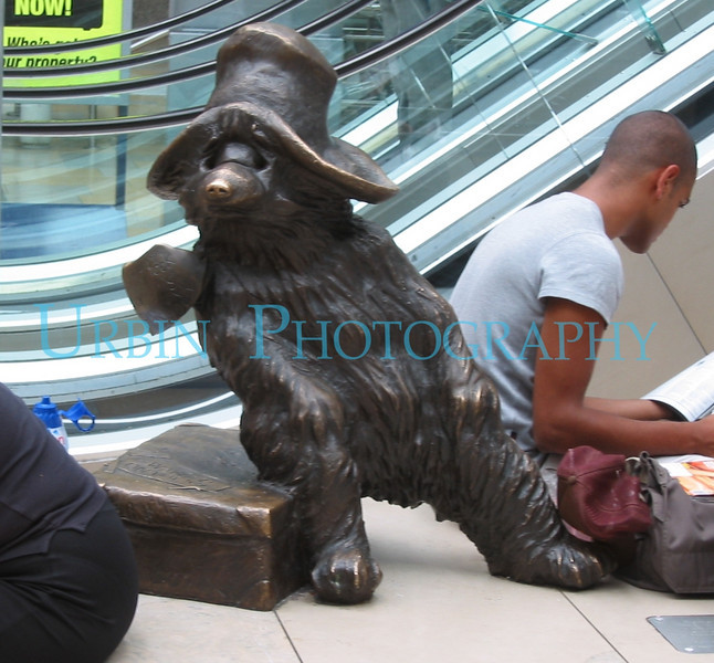 A statue of Paddington Bear in Paddington Station in London.