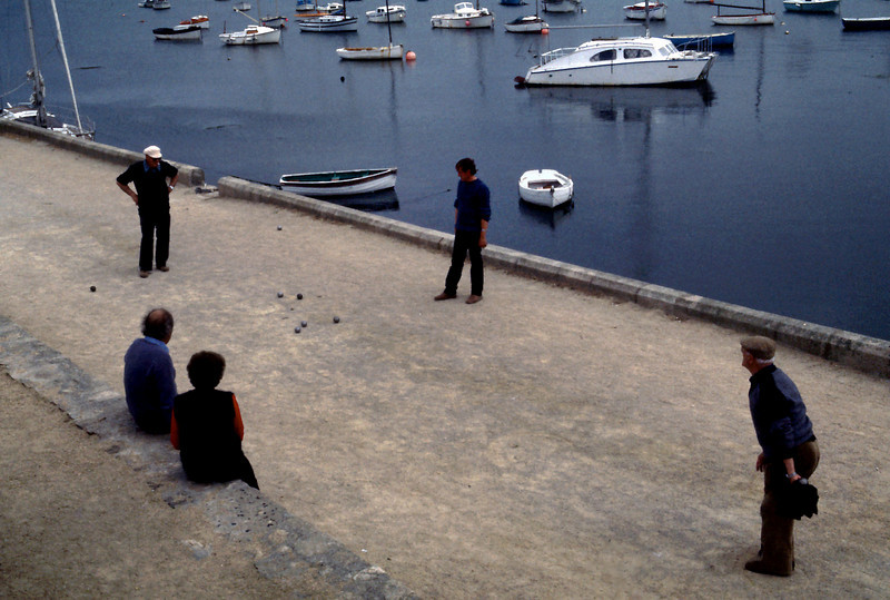 """Boules<br /> <br /> Day 60 (cont) - While I watched the busy harbor: boats loading and unloading, boats coming and going, boats getting painted, and old men playing the ever popular game of boules; Rita shopped for some French food items to ship home.<br /> <br /> NEXT: Click the link below to see Devon, southern England<br /> <a href=""""https://garywright.smugmug.com/Travel/European-Bicycle-Tour/Devon-Southern-England/"""">https://garywright.smugmug.com/Travel/European-Bicycle-Tour/Devon-Southern-England/</a>"""
