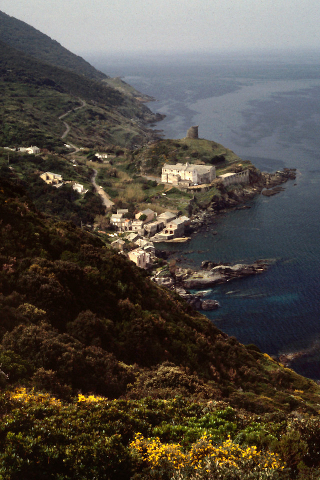 Coastal village, Cap Corse, Corsica<br /> <br /> What few villages we saw were either down by the sea, or up on top of a ridge. For a bicyclist, that means loosing or gaining elevation.