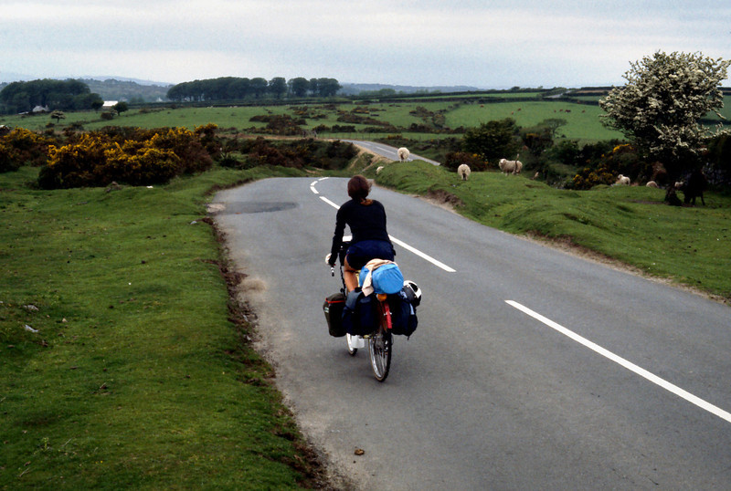 Rita Cycling - Devonshire<br /> <br /> Day 61 - June 10 - After a few hours of fitful sleep on the ferry from Roscoff, I staggered out onto the deck in time to see a dull orange sun shining over the cliffs of England. By 6:30 am we had rolled our bikes down the gangplanks, had been waved through customs without incident, and were pedaling off down the wrong side of the road, leaving Plymouth behind and headed towards Dartmoor National Park.