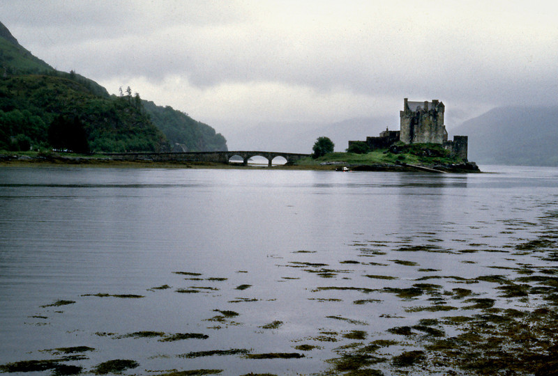 Eilean Donan Castle<br /> <br /> Day 84 - July 3 - Loch Garry - 37 miles - There is a castle at Eilean Donan, built in 1919, on the foundation of a 200 year old ruin. The tour was only two rooms, but interesting and very well furnished. At tours end we discovered the rain had diminished to a light mist, but with a tail breeze, it wasn't too bad.