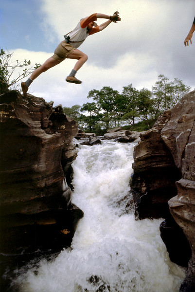 Tim's Heroic Leap<br /> <br /> Tim thrilled us all by leaping from one high rock bank to the opposite side, and impossible distance over churning white froth and certain death should he have failed.