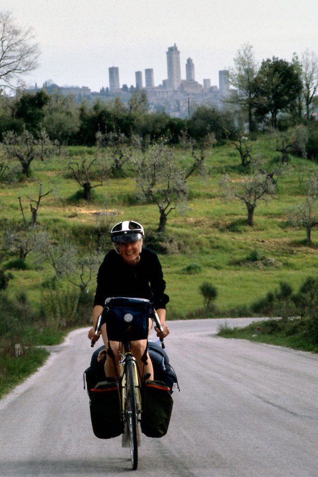 Rita, Leaving San Gimignano<br /> <br /> Day 14 - April 24 - We paid our camp tab and got back on the road about 9:00. Today we retraced yesterday's hilly route via P47 to Castle San Gimignano, but this time with loaded bikes. Ouch. Instead of going to Col d'val Elsa, we turned west towards Volterra on S68 - long steep climbs through green mountains, sheep grazing below us, tinkling their bells - I was beginning to wonder if we hadn't stumbled into Switzerland by mistake.