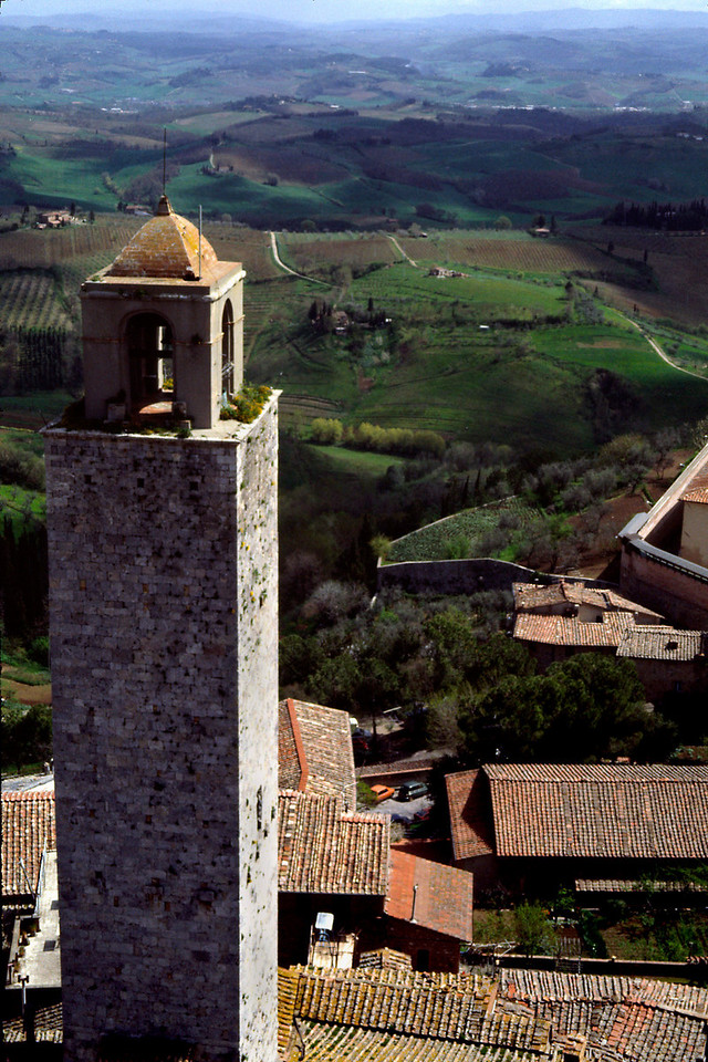 San Gimignano Tower<br /> <br /> Day 11 - April 21 - The ancient walled city of San Gimignano is a delightful maze of narrow brick paved alleyways, stone archways, fantastic shops, and, above it all, fifteen square stone towers like some medieval Manhattan in miniature.