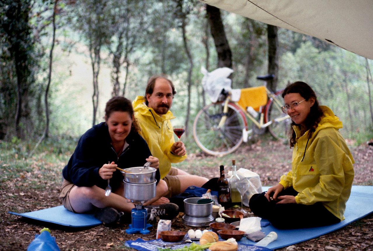 Camp near San Gimignano<br /> <br /> The return ride from San Gimignano back down the hill to camp was swift. The gray sky threatened rain, so we rigged the tarp. Cozy under our tarp in the rain, we enjoyed a super supper of tortellini, bread and wine.