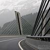 Swiss bridge in front of the Alps.
