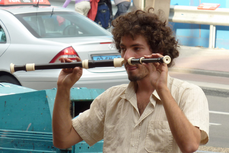 Man playing an instrument with his NOSE!