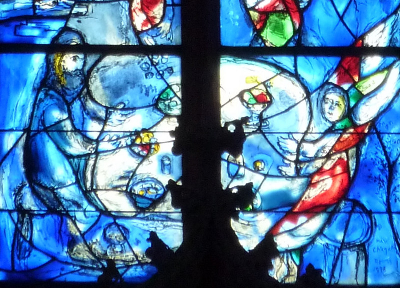 The Chagall choir windows in St. Stephan are unique in Germany. Between 1978 and his death in 1985, Russian Jewish artist Marc Chagall created nine stained-glass windows of scriptural figures in luminous blue. The figures depict scenes from the Old Testament, demonstrating to the commonalities across Christian and Jewish traditions. Chagall intended his work to be a contribution to Jewish-German reconciliation, made all the more poignant by the fact that Chagall himself fled France under Nazi occupation.