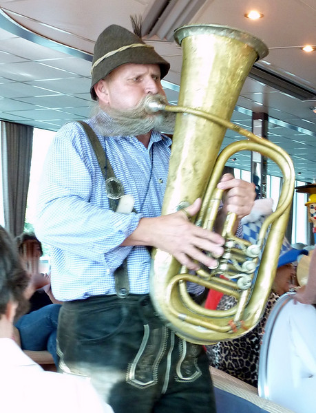 Hansi, a one-man band performs onboard 'The Danube.'