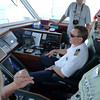 The captain gets a few pointers from the guests on steering the ship