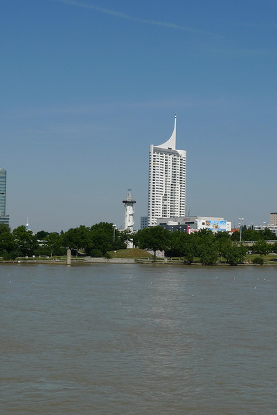 """Modern Vienna as seen from the river. The tower in the distance is the Millenium Tower and has 51 floors, serves both commercial and residential purposes, and is the focal point of a complex known as """"Millennium City""""."""