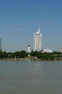 "Modern Vienna as seen from the river. The tower in the distance is the Millenium Tower and has 51 floors, serves both commercial and residential purposes, and is the focal point of a complex known as ""Millennium City""."