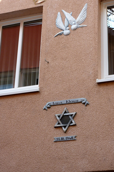 A house decorated to honor one of the last Jewish families removed from the city during the Nazi period.