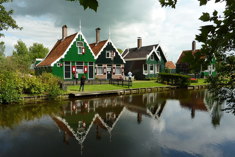 Neighboring houses reflected in the canal