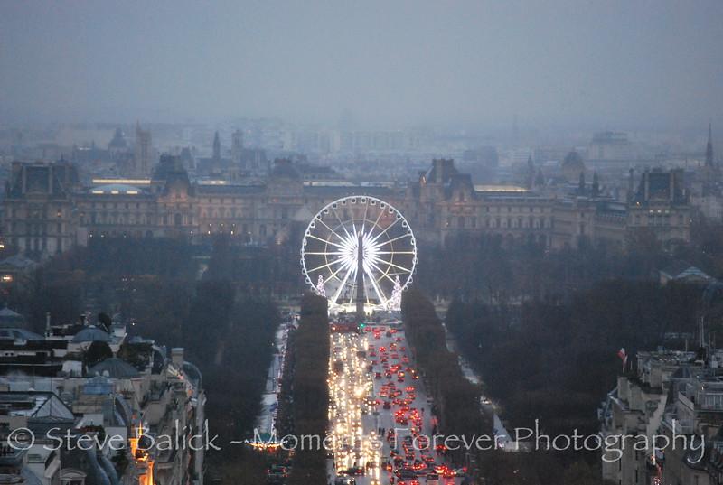 The Ferris wheel at the other end of La Rue de la Champs D'Elysse from L'Arc De Triomphe.
