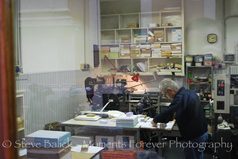 We loved this scene.  I know there's reflections, but this was a small shop in Rome with an actual printing press.