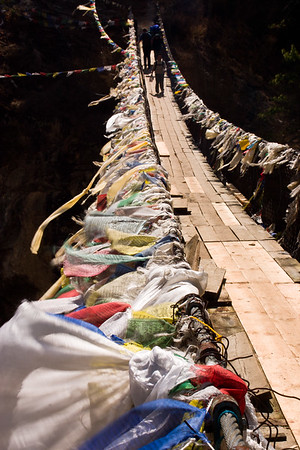 Footbridge and flags below Namche