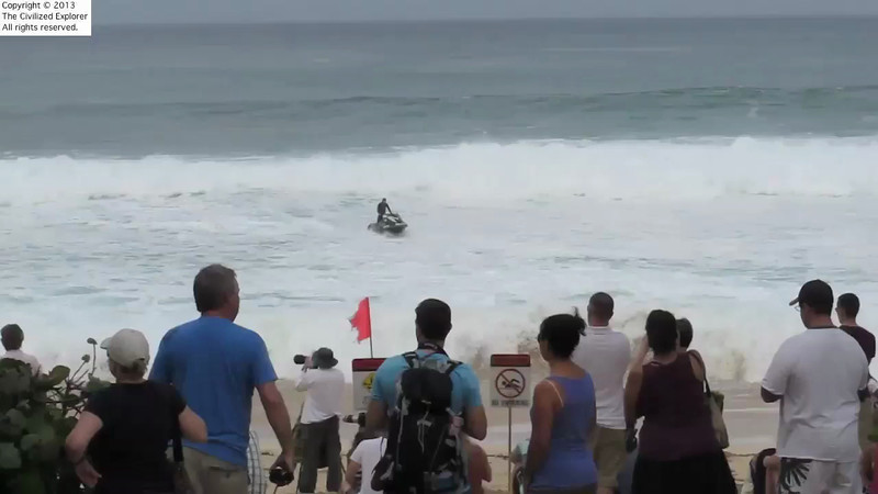 A jet skier prepares to tow a body surfer out into the Pipeline.