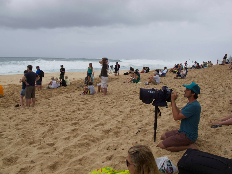 This is the Pipeline on a big wave day. Lots and lots of video and photos going on, along with an appreciative crowd just watching.