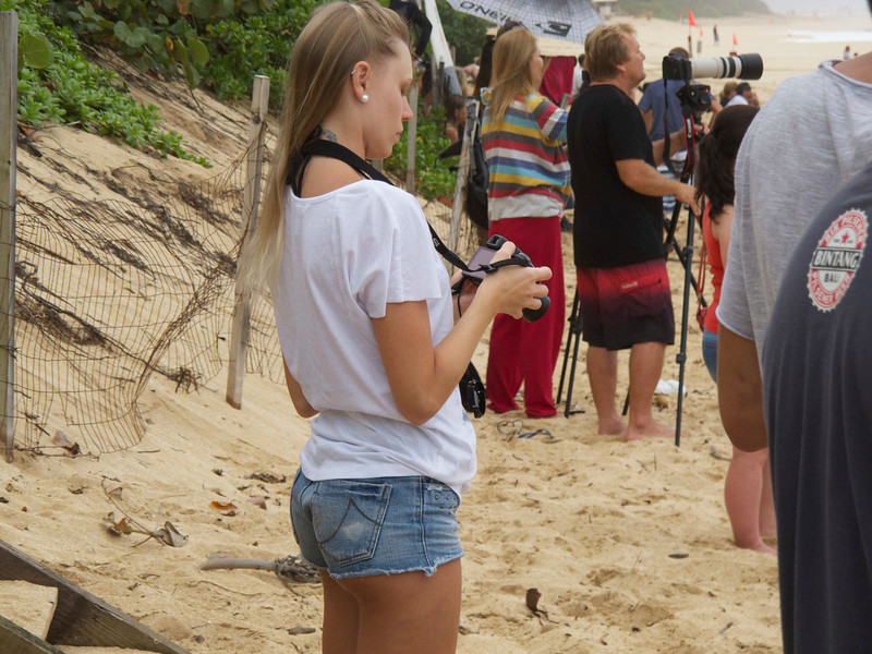 Big crowds and lots of photographers at the Pipeline section during a heavy surf day.