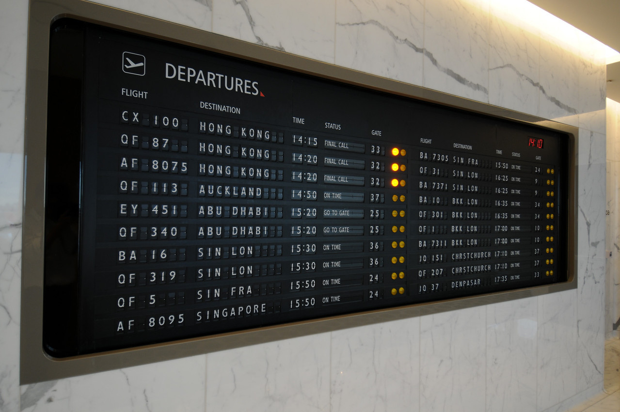 Awesome vintage-looking departures board in the QANTAS lounge in Sydney.