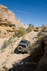 Creping up the Hill - Nanette Following Ryan in the San Rafael Swell - Photo by Pat Bonish
