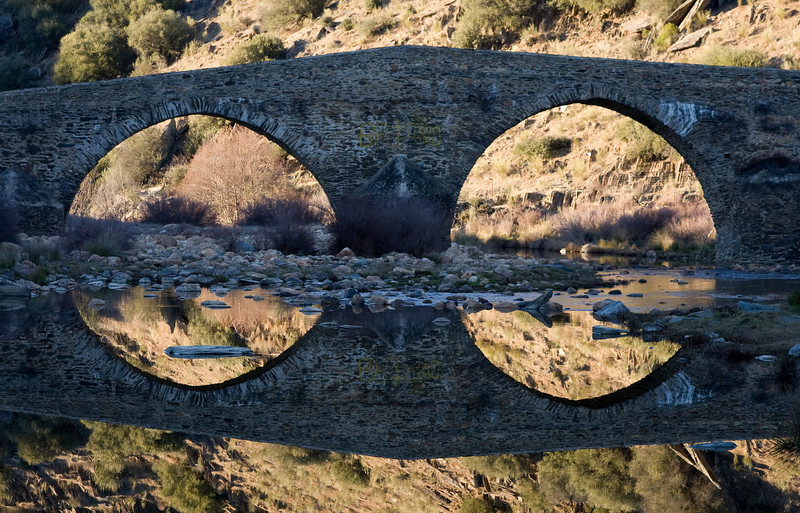 Old bridge with reflection
