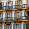 Apartments along the Plaza de la Constitucion in San Sebastian. Even with the rain pouring down, cleaning has to be done