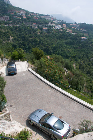 Looking down from the streets of Eze.  Fancy cars and stunning views of the mountain descending into the sea.