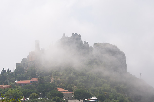 Eze sits high on a mountain top shrouded with clouds.
