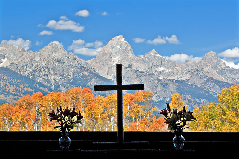 TETON RANGE AS VIEWED FROM A WINDOW IN THE CHAPEL OF TRANSFIGURATION
