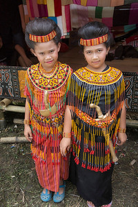 Sulawesi - Toraja Village Funeral Ceremony 2 of the young family girls in ritual clothing
