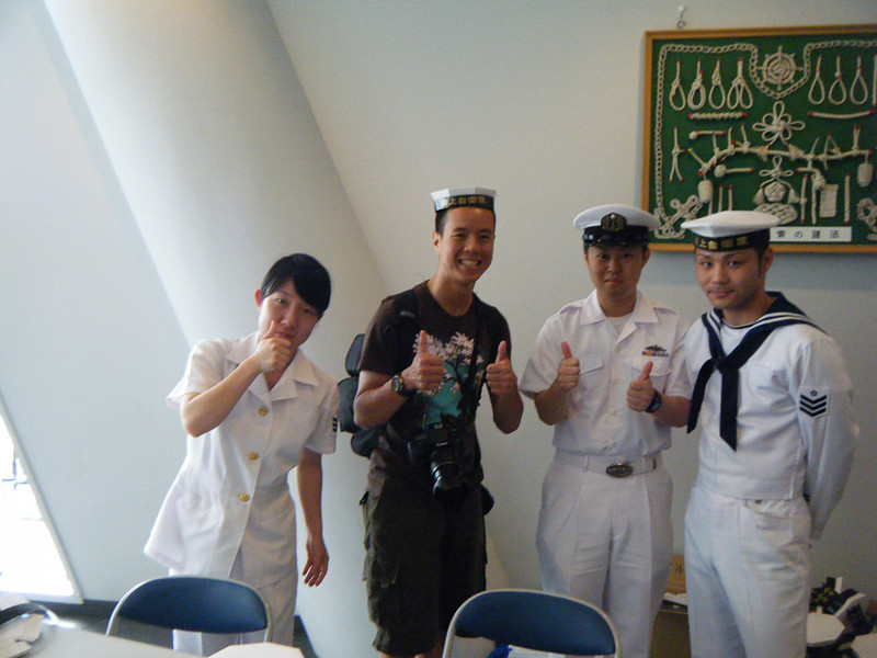 I get an awkward photo with a JMSDF recruing booth.  They gave me a free paper hat.