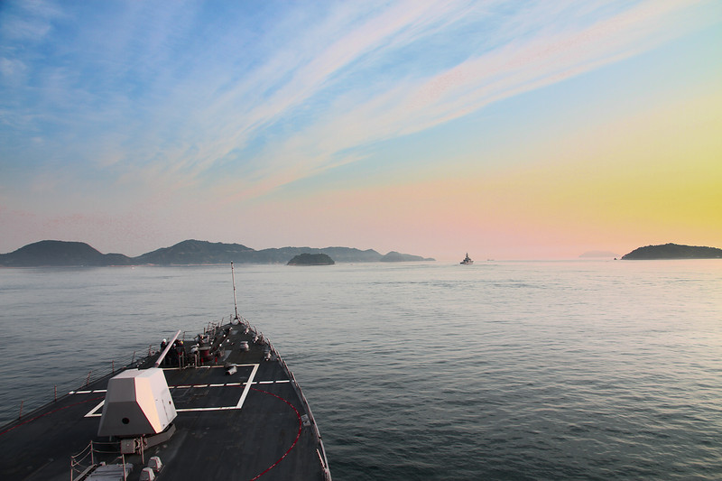 The sun rises as we begin to enter the passage to Kure and Etajima.  We're following the Hiei, off in the distance.