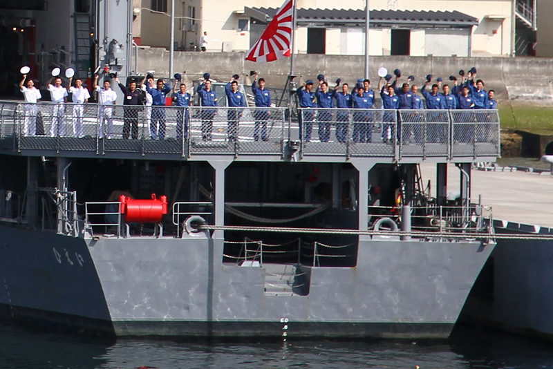 The Hiei sailors wave farwell to us.