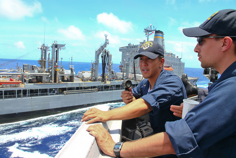 MIDN Alan Alegre conns the USS Mustin as we sail alongside the USS Walter S. Diehl for an underway replenishment.