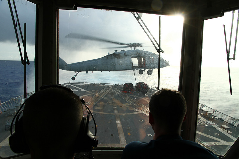 A SH-60 picks up VERTREP pallets from our flight deck.