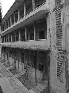 Barbed wired school is Toul Sleng Prison Museum in Phnom Phen Cambodia