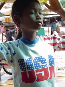 Cambodian girl sells in USA t-shirt