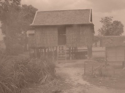 Classic Cambodian house on stilts for monsoon rains in sepia