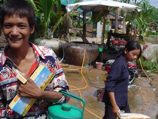 Cambodian boy selling cigarettes