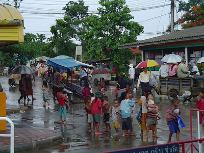Cambodian children on Thai border begging in rain